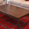 Walnut coffee table with riveted base
